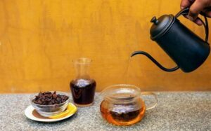 image of coffee cherry tea being poured