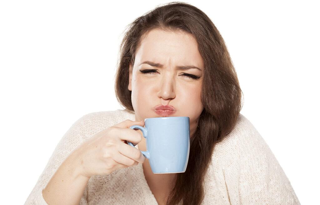 visualizes woman with coffee mug to impart impression of coffee plus fatigue